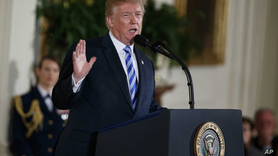 President Donald Trump speaks during the Public Safety Medal of Valor awards ceremony in the East Room of the White House, Feb. 20, 2018, in Washington.