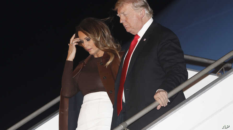 President Trump and first lady Melania Trump walk from Air Force One, Nov. 29, 2018, as they arrive in Buenos Aires, Argentina.