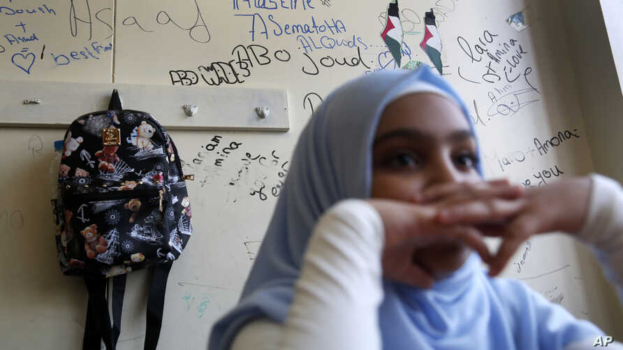 A Palestinian refugee student sits inside her classroom as she attends the first day of a new school year, at one of the UNRWA schools, in Beirut, Lebanon, Monday, Sept. 3, 2018.
