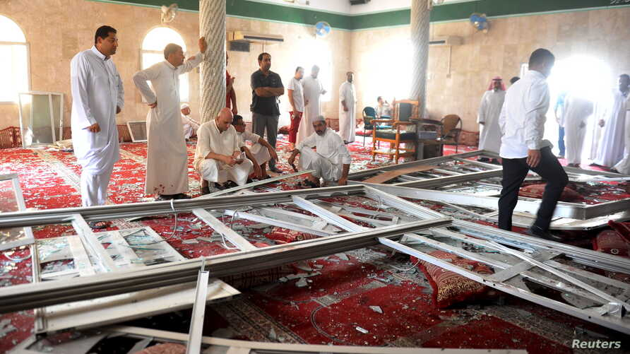 Family members of victims and well wishers are seen after a suicide bomb attack at the Imam Ali mosque in the village of al-Qadeeh in the eastern province of Gatif, Saudi Arabia, May 22, 2015.