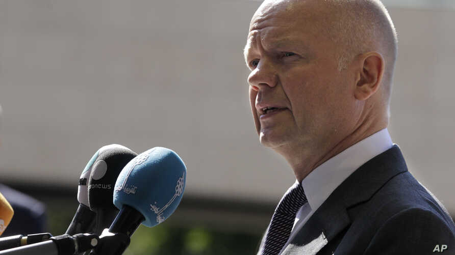 British Foreign Secretary William Hague addressees the media upon arrival at the EU foreign ministers council at the European Council headquarters in Luxembourg city, Luxembourg, June 23, 2014.