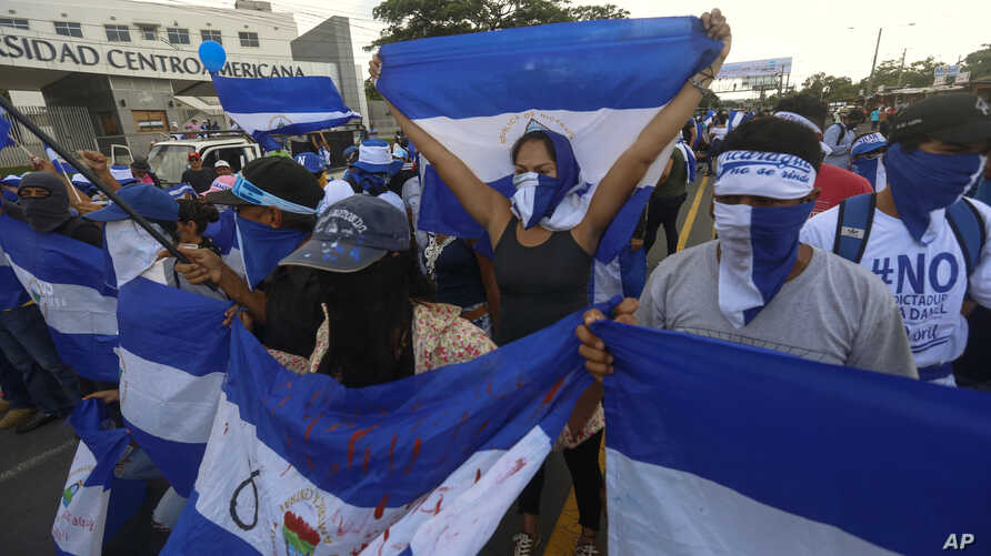 Anti-government protesters march outside the Central American University in Managua, Nicaragua, Sept. 26, 2018, before police blocked the march from reaching its planned destination, the local U.N. headquarters.