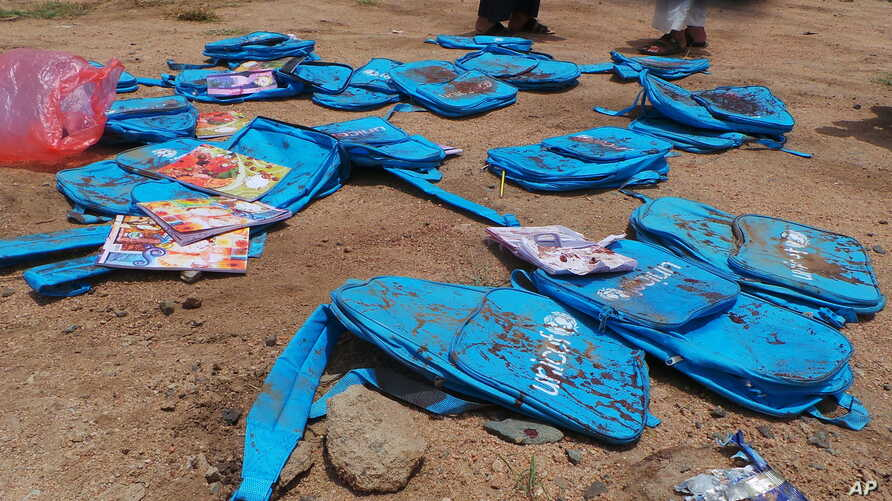 Children's backpacks lie at the site a day after an airstrike in Saada, Yemen on Aug. 10, 2018.