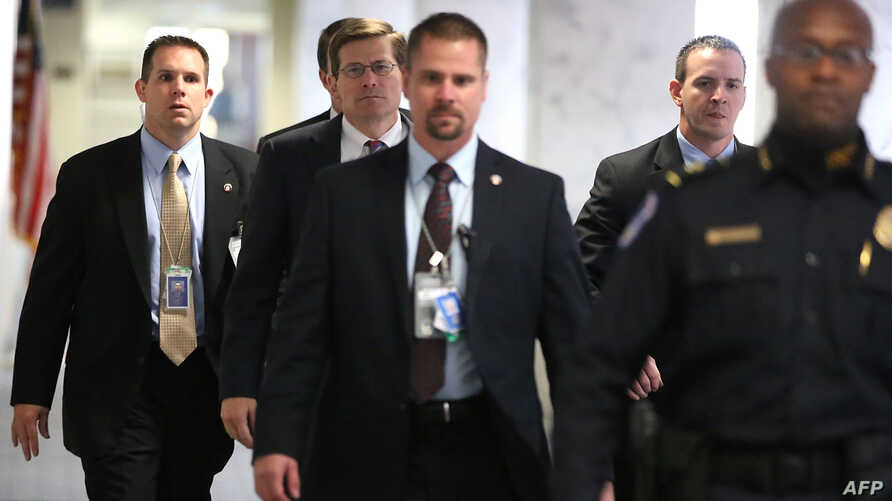Acting CIA Director Michael Morell (2nd L) arrives Capitol Hill to attend closed-door meetings before the Senate Select Intelligence Committee, Washington, November 15, 2012.