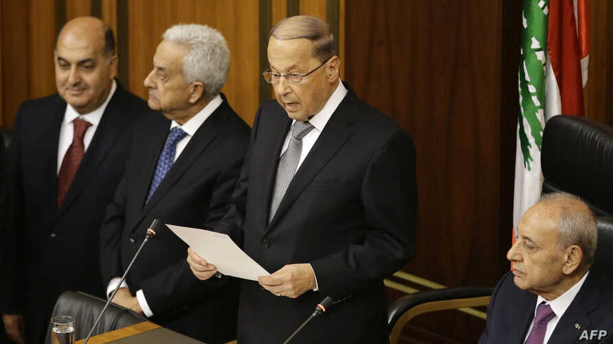 Newly elected Lebanese President Michel Aoun (C) gives a speech next to the Parliament Speaker Nabih Berri (R) as he takes an oath at the Lebanese parliament in downtown Beirut, Oct. 31, 2016.