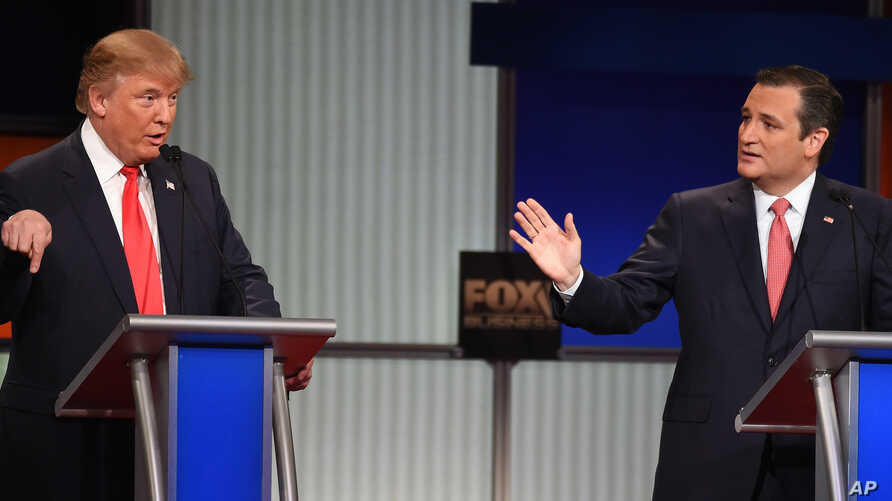 Republican presidential candidate businessman Donald Trump, left, and rival Sen. Ted Cruz, R-Texas, both speak during the Fox Business Network Republican presidential debate at the North Charleston Coliseum, Jan. 14, 2016, in North Charleston, S.C.  ...