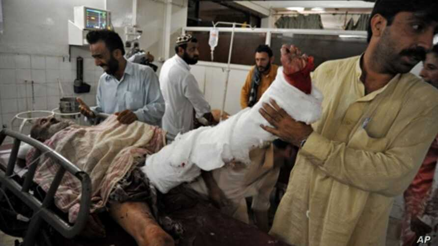 Man receives treatment after being injured by suicide bombing in Peshawar,  Pakistan 23 Aug 2010.
