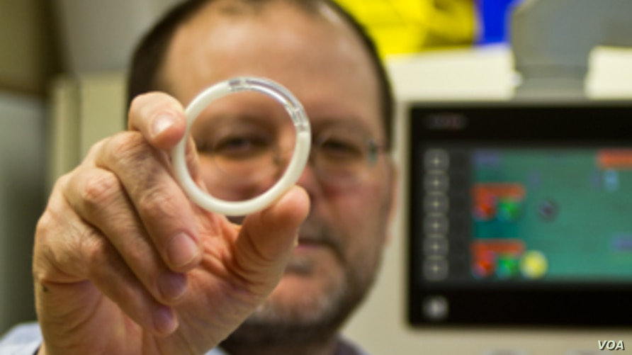 Caption: Northwestern University biomedical engineer Patrick Kiser holds an intravaginal ring -- the first of its kind -- that reliably delivers an antiretroviral drug and a contraceptive for months. (Northwestern University)
