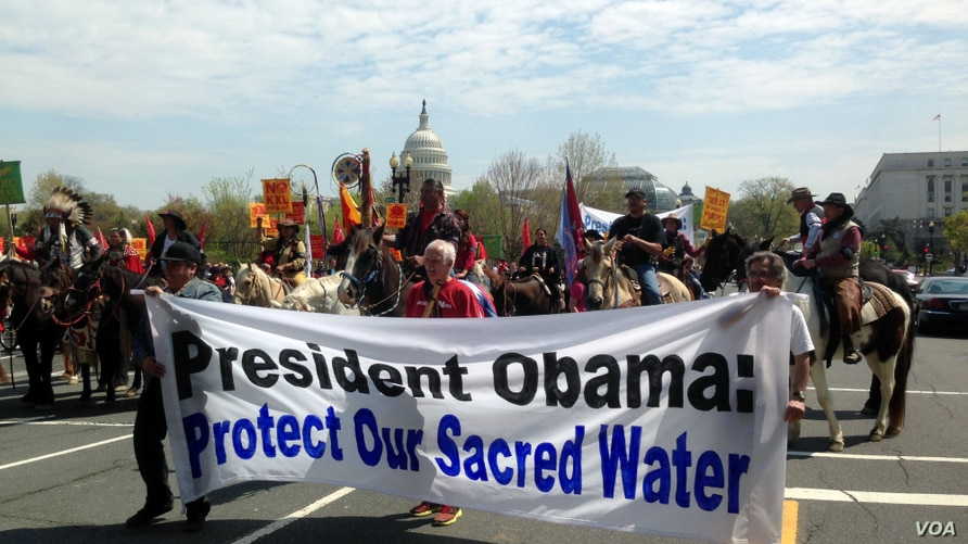 "Native Americans, farmers, ranchers and cowboys gather outside the Capitol Hill in Washington, DC, during a '""Reject and Protect'"" rally to protest against the Keystone XL tar sands pipeline, April 22, 2014. (Diaa Bekheet/VOA)"