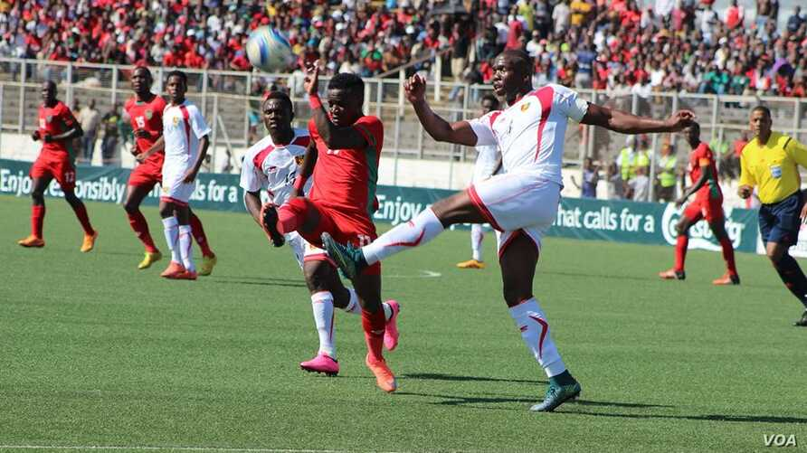 Malawi, in red, plays against Guinea during the Africa Cup of Nations qualifiers at Kamuzu Stadium in Blantyre in 2016. (Photo courtesy of Patrick Lunda)