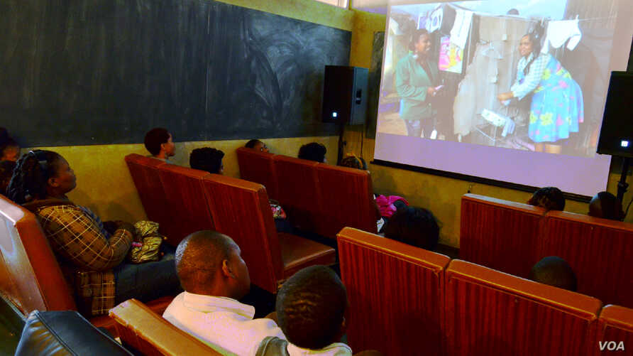 A group watches their movie at the Bioscope Independent Cinema after making a film at the Home Movie Factory in Johannesburg, South Africa. (Peter Cox/VOA)