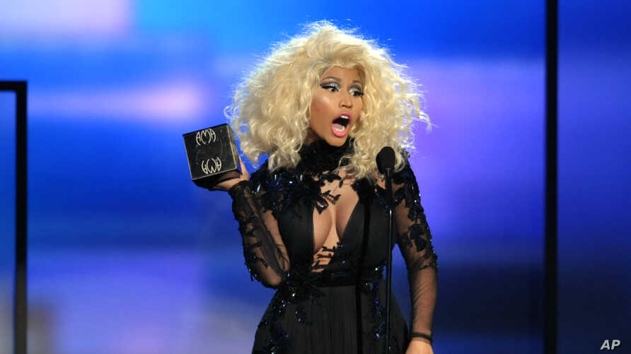 Nicki Minaj accepts the award for favorite artist - rap/hip-hop at the 40th Anniversary American Music Awards on Nov. 18, 2012, in Los Angeles.