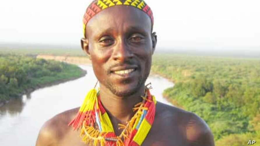 A tribesman near the Omo River in Ethiopia. Rights and environmental groups say traditional life in the area would change for the worse if the controversial Gibe III dame is built.