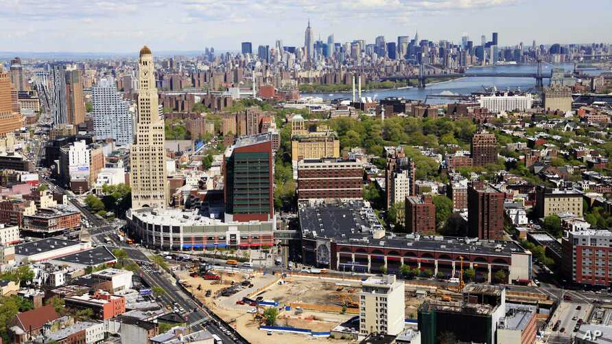 FILE - the construction site of Atlantic Yards in downtown Brooklyn, foreground, is shown with the New York skylne in the distance.