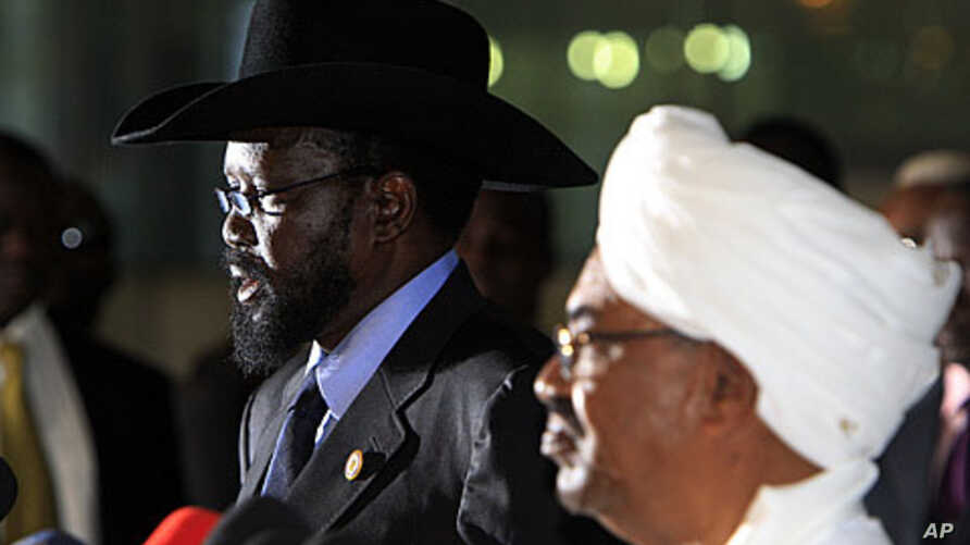 Sudanese President Omar al-Bashir (R) listens as his South Sudanese counterpart Salva Kiir speaks during a joint news conference, before Kiir's departure at Khartoum Airport October 9, 2011.