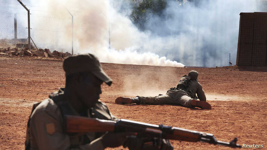 FILE - Malian soldiers are seen training in Koulikoro February 6, 2014.