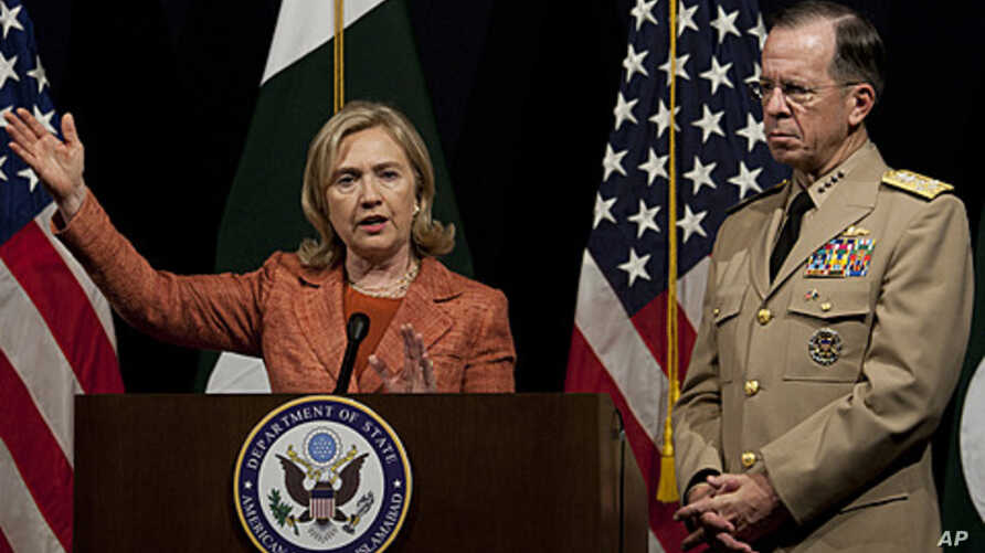U.S. Secretary of State Hillary Rodham Clinton addresses a news conference with Adm. Mike Mullen, the chairman of the U.S. Joint Chiefs of Staff at U. S. embassy in Islamabad, Pakistan, May 27, 2011.