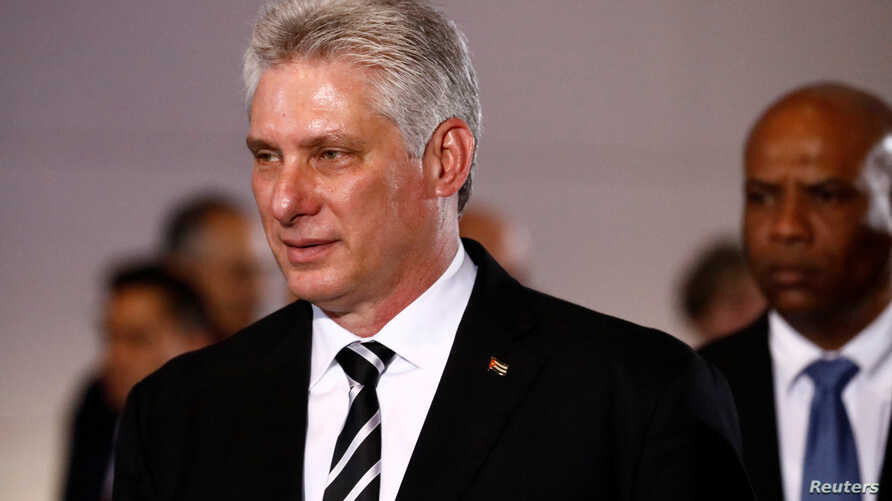 FILE - Cuba's President Miguel Diaz-Canel attends a ceremony at the National Pantheon in Caracas, Venezuela, May 30, 2018. On July 21, 2018, Cuban lawmakers Diaz-Canel's Cabinet, keeping most of the ministers from Raul's Castro government in place.
