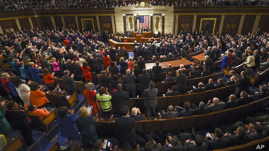 President Barack Obama is applauded as he gives his State of the Union address before a joint session of Congress on Capitol Hill in Washington, Jan. 12, 2016.