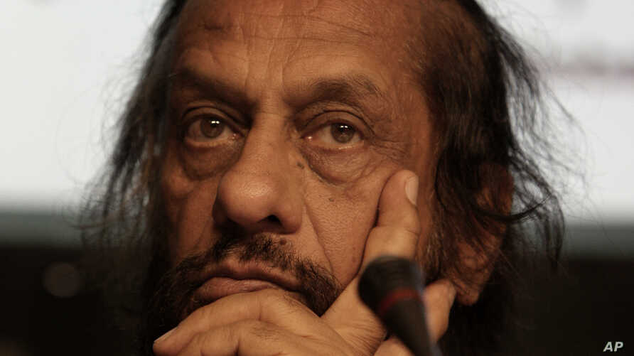 FILE - Rajendra Kumar Pachauri, Chairman of the Inter- governmental Panel on Climate Change, IPCC, listens during a briefing at the UN Climate Summit in Copenhagen.