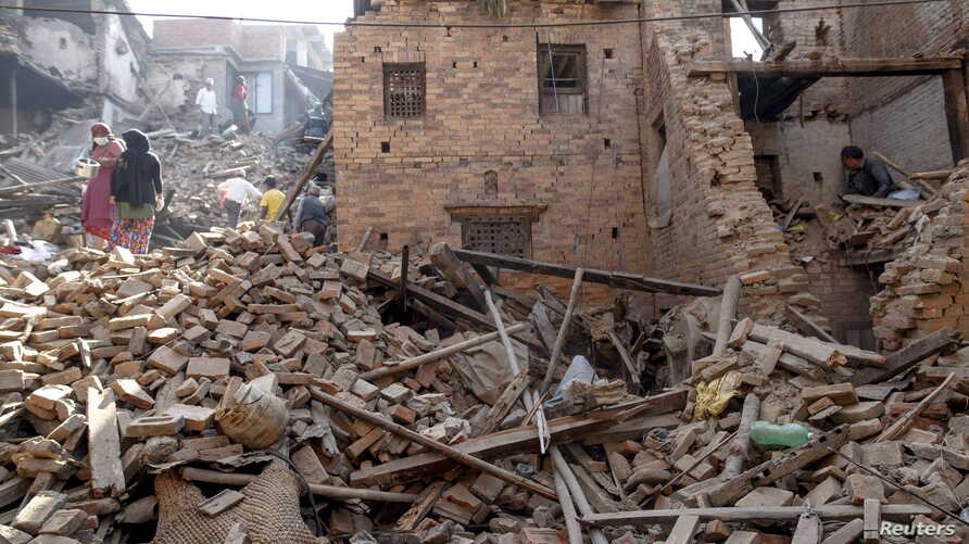Local residents clear the rubble from their homes which were destroyed after last week's earthquake in Bhaktapur, Nepal, May 4, 2015.