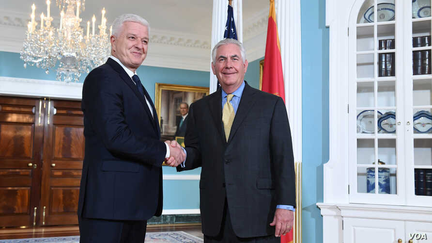 U.S. Secretary of State Rex Tillerson shakes hands with Montenegrin Prime Minister Dusko Markovic before their meeting at the U.S. Department of State in Washington, D.C., May 8, 2017.