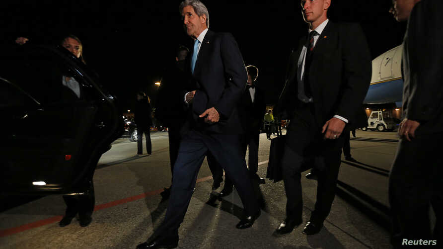 U.S. Secretary of State John Kerry is surrounded by security as he arrives in Geneva, April 16, 2014.
