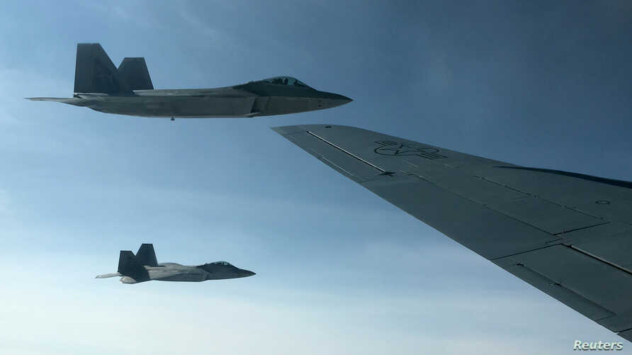 Two U.S. Air Force F-22 stealth fighter jets are about to receive fuel midair from a KC-135 refueling plane over Norway en route to a joint training exercise with Norway's growing fleet of F-35 jets, Aug. 15, 2018.