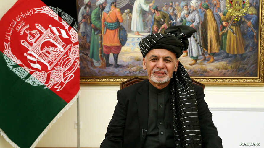 Afghanistan's President Ashraf Ghani speaks during a live TV broadcast at the presidential palace in Kabul, Afghanistan, Jan. 28, 2019.