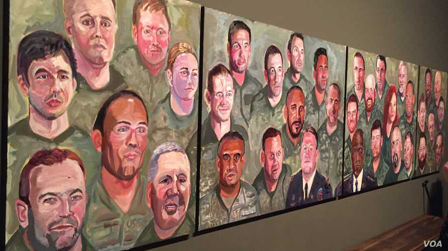 "A panoramic view of paintings from former president George W. Bush's ""Portraits of Courage"" series is seen at the Bush Presidential Museum in Dallas, Texas. (K. Farabaugh/VOA)"