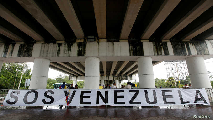 A banner is seen outside the site where the Organization of American States 47th General Assembly is taking place in Cancun, Mexico June 21, 2017.