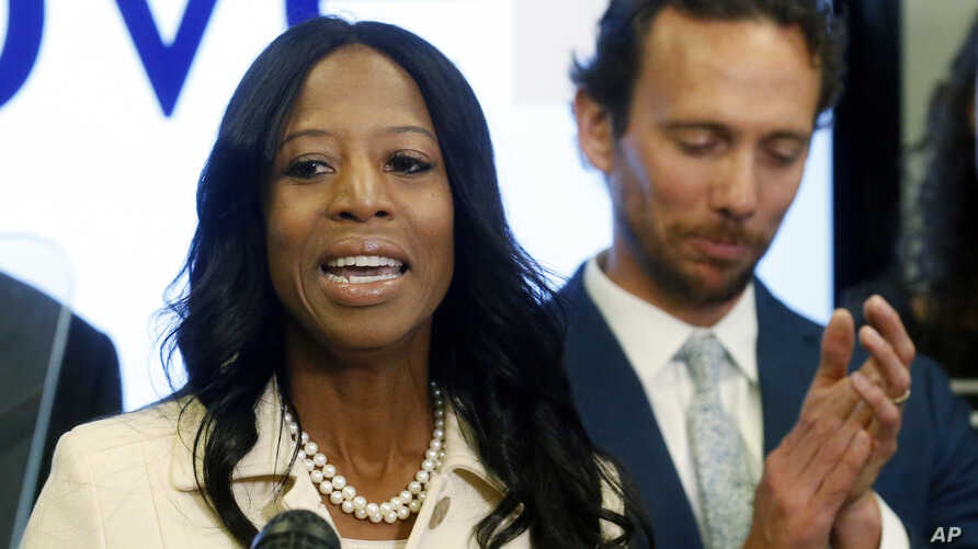 Surrounded by her family, Rep. Mia Love, R-Utah, talks about election results in the 4th Congressional District at the Utah Republican Party headquarters, Nov. 26, 2018, in Salt Lake City.