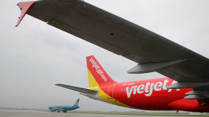 A VietJet A320 airplane is seen while parking before departure for Bangkok at Noi Bai international airport in Hanoi September 25, 2013.