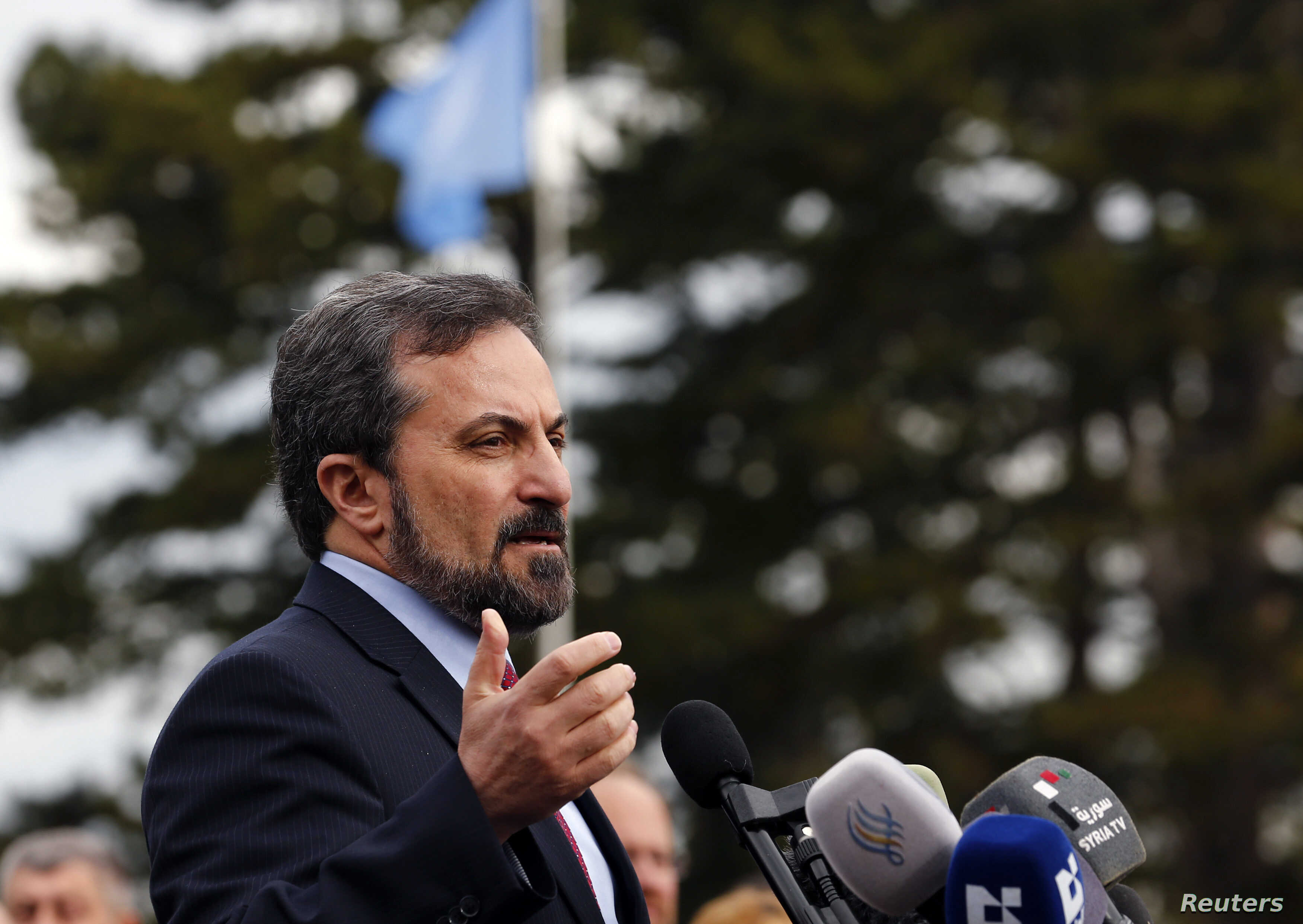 Syrian National Coalition spokesperson Louay Safi addresses the media after a meeting at the Geneva Conference on Syria, February 15, 2014.