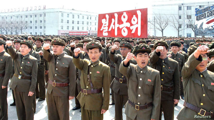 North Koreans attend a rally against the United States and South Korea in Nampo, North Korea, April 3, 2013.