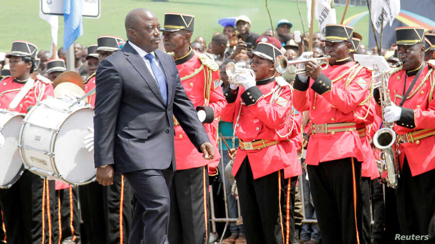 Democratic Republic of the Congo President Joseph Kabila inspects a guard of honor during the anniversary celebrations of the DRC's independence from Belgium in Kindu, DRC, June 30, 2016.