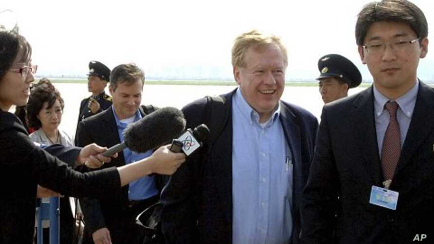 In this Tuesday, May 24, 2011 photo released by Korean Central News Agency via Korea News Service in Tokyo, Amb. Robert King, center, a U.S. special envoy for North Korean human rights issue, and his party arrive at Pyongyang airport in North Korea.