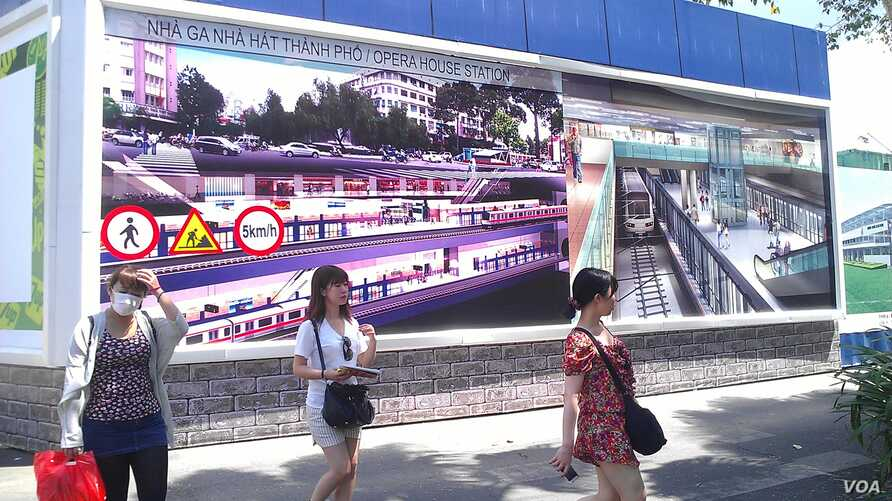The construction banner at a future metro stop in Ho Chi Minh City. (Lien Hoang for VOA News)