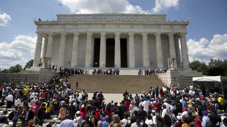Participants gather on the steps of the Lincoln Memorial during an event to commemorate the 50th anniversary of the 1963 March on Washington, Aug. 24, 2013.