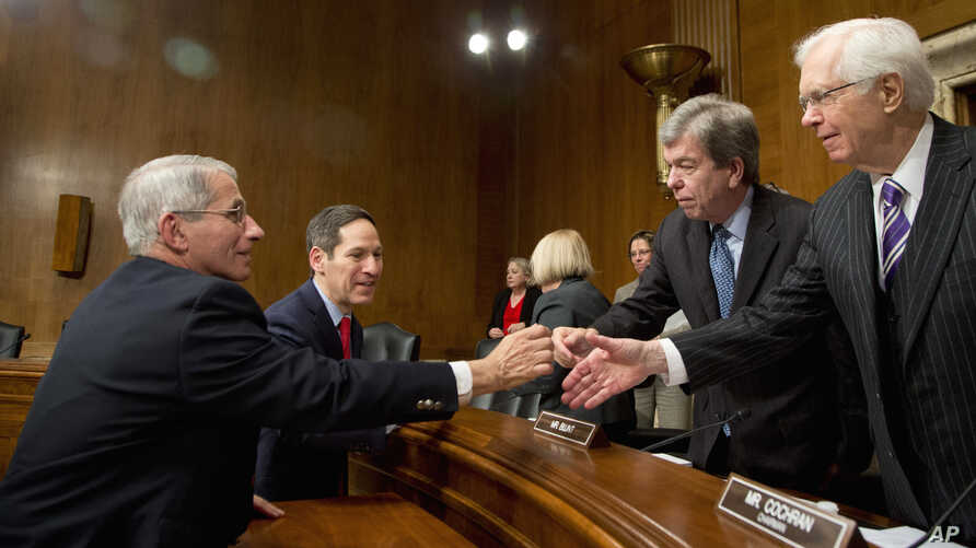 NIH National Institute of Allergy and Infectious Diseases Director Anthony Fauci, left, and CDC Director Thomas Frieden, second from left, shake hands at conclusion of subcommittee hearing on Zika, on Capitol Hill, Feb. 11. 2016.