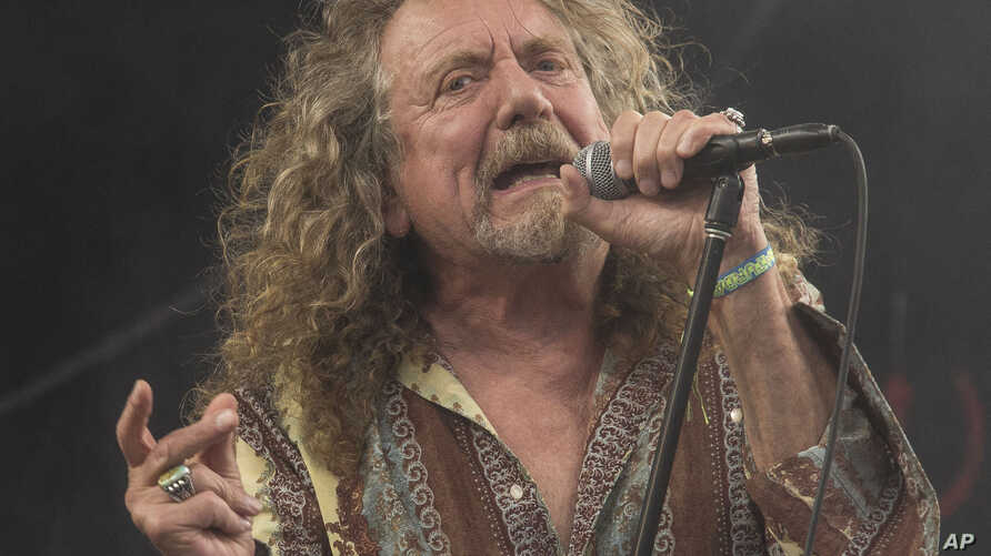 FILE - Robert Plant performs at Glastonbury music festival, in England, June 28, 2014.