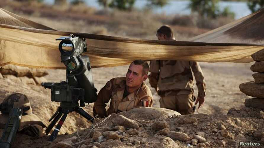 French troops take up positions in northern Mali january 19, as a French-led military offensive drives al-Qaida-lined rebels from the larger towns and cities in the region.