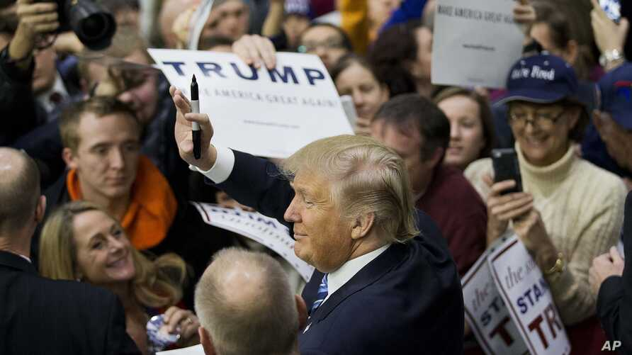 Republican presidential candidate, billionaire Donald Trump, gestures to the crowd as he signs autographs at a campaign event at Plymouth State University Sunday, Feb. 7, 2016, in Plymouth, New Hampshire.
