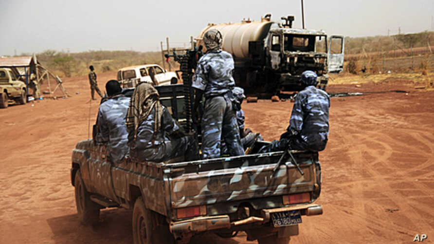 Sudanese armed forces ride a military vehicle at the oil-rich border town of Heglig, Sudan, April 24, 2012.