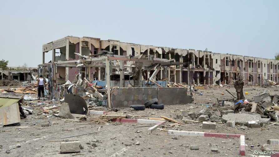 Damaged houses are seen one day after a Saudi-led air strike hit them in Yemen's western city of Mokha, July 26, 2015