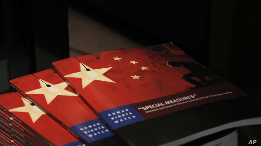 Copies of the new report by Human Rights Watch are seen at The Foreign Correspondents' Club in Hong Kong, Dec. 6, 2016.