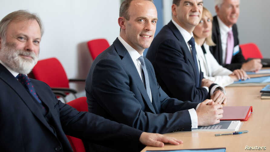 Britain's Secretary of State for Exiting the European Union Dominic Raab (C) and Britain's ambassador to the European Union Tim Barrow (L) attend a meeting with European Union's chief Brexit negotiator Michel Barnier in Brussels, Belgium, July 19, 20