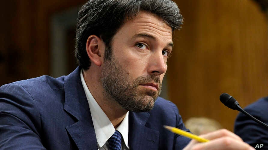 Actor and Eastern Congo Initiative Founder Ben Affleck listens to testimony on Capitol Hill in Washington, Feb. 26, 2014, during the Senate Foreign Relations Committee hearing on the Congo.