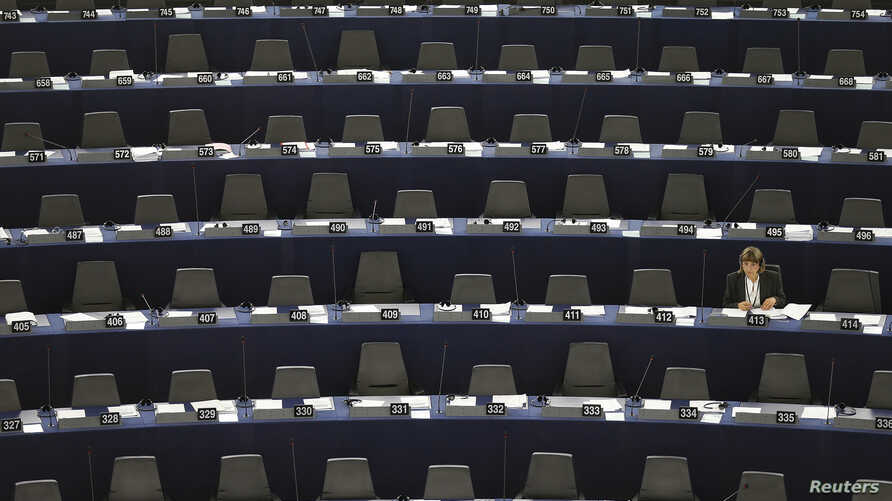 FILE - A member of the European Parliament attends a debate on the state of union, in Strasbourg, September 11, 2013.