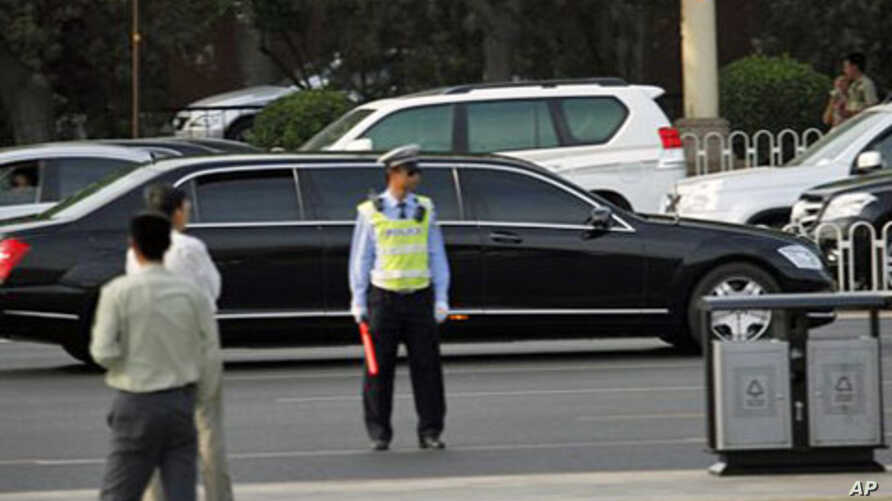 A stretch limousine believed to be carrying North Korean leader Kim Jong Il drives ahead of a convoy of cars traveling towards the Great Hall of the People in Beijing, China, May 25, 2011